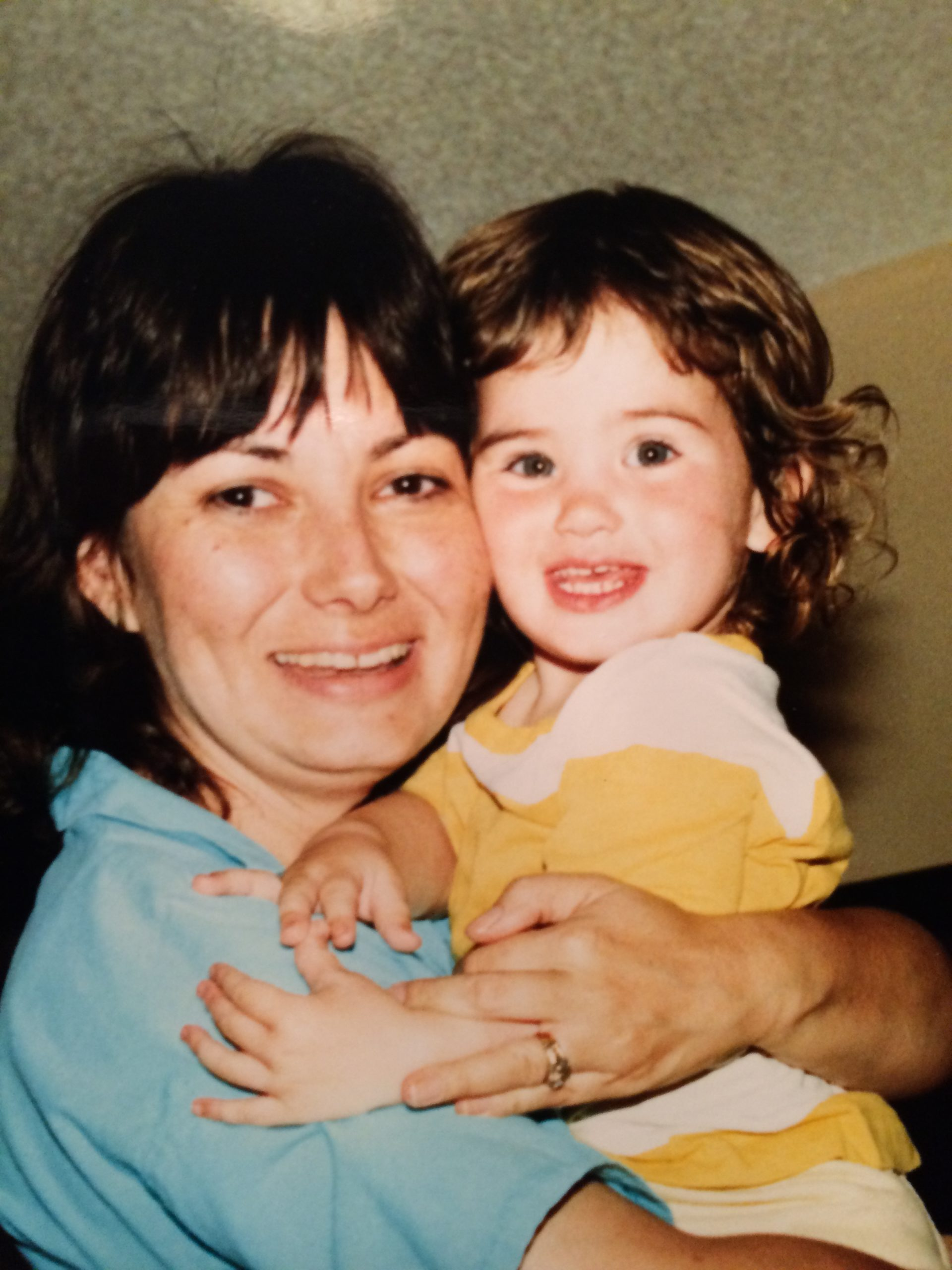 Author as a toddler being held by her mother