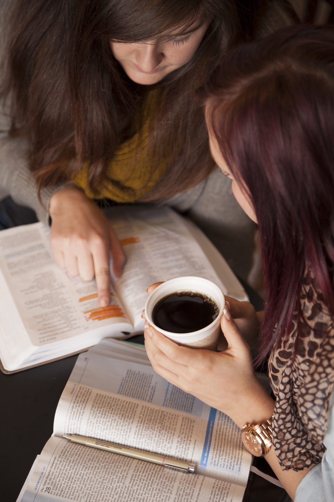Woman and teen doing a Bible study together